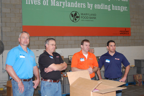 Employees of Phusion Projects, the makers of Four Loko, volunteer at Maryland Food Bank. The company also ...