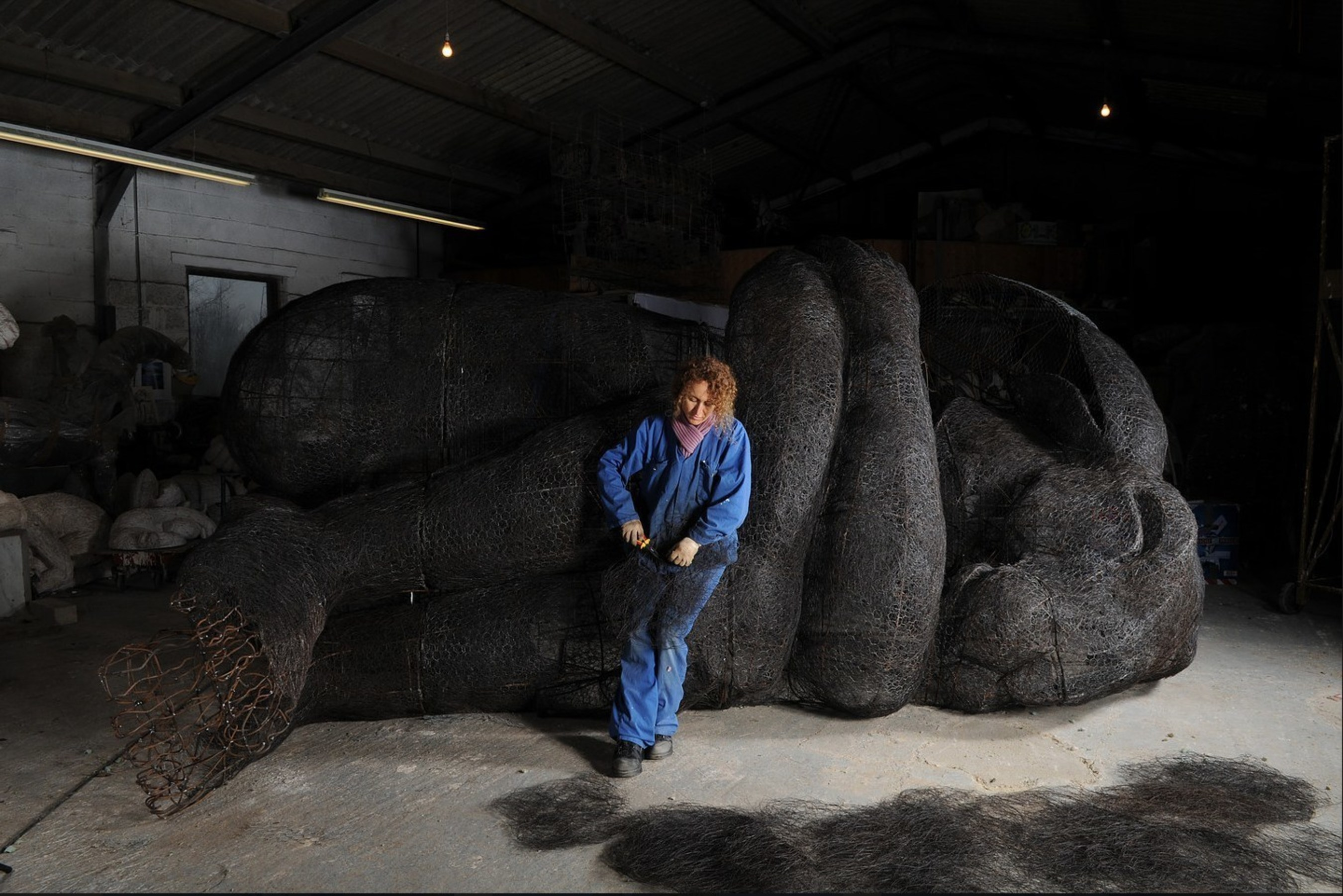 """Sophie Ryder working on """"Curled Up No. 2"""""""