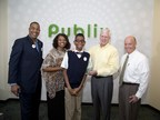 """LAKELAND, FLORIDA - March 2015 - """"March of Dimes National Ambassador Family Todd Jackson, Elise Jackson and Elijah Jackson recently presented Publix CEO Ed Crenshaw and President Todd Jones with the Crystal Award at their corporate headquarters in Lakeland, Florida for being named the #2 March for Babies National Team in 2014"""""""