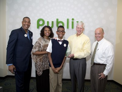 "LAKELAND, FLORIDA - March 2015 - ""March of Dimes National Ambassador Family Todd Jackson, Elise Jackson and Elijah Jackson recently presented Publix CEO Ed Crenshaw and President Todd Jones with the Crystal Award at their corporate headquarters in Lakeland, Florida for being named the #2 March for Babies National Team in 2014"""