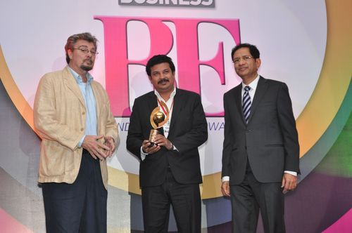 Zee Business Award received by Mr. Jacob Mathew, Head Image & Communication from Mr. David Forbes, President and CEO, Forbes Consulting Group and Mr. Atul Nishar, Chairman, Hexaware Technologies (PRNewsFoto/Zuari Cement Limited)