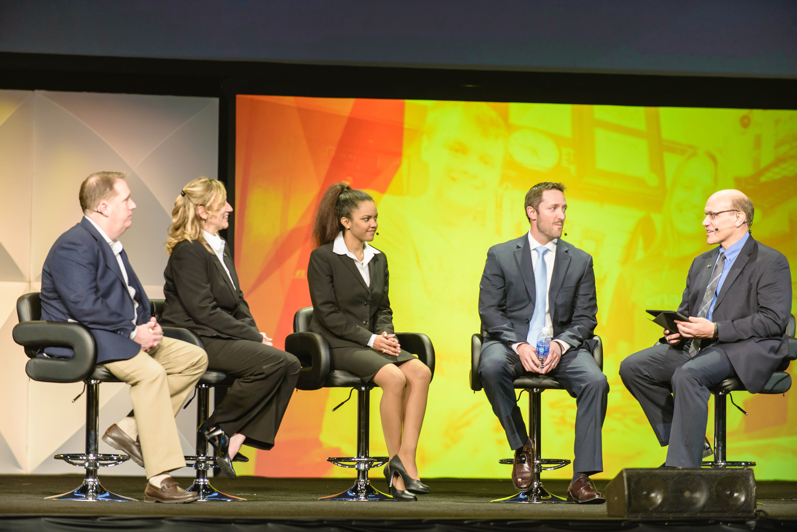 Members discuss opportunities to network and collaborate at the Enactus United States National Exposition Opening Round Ceremony. (L to R) Mike Moore: Chairman, Enactus United States National Advisory Board, EVP and President of Small Formats for Walmart US, Walmart Stores, Inc.; Cynthia Wood; Chelsea Watkins; Tim Clow; Alex Perwich: President, Enactus United States