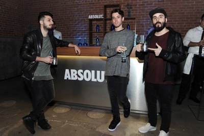 Cash Cash sips electric blue Absolut Vodka cocktails to celebrate the return of limited edition holiday bottle - Absolut Electrik - during a performance in NYC on Nov 4th