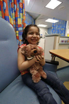 "United Airlines' customers can now bring smiles and bear hugs to kids in need with a contribution to Happy Hearts Fund. For each donation, United will deliver a limited-edition GUND? teddy bear, ""Ben Flyin,"" to children experiencing health struggles or economic hardship in communities the airline serves worldwide. Ben Flyin, the seventh limited-edition bear in the United Adventure Bear program, aims to lift the spirits of children across the globe. The furry travel companion comes complete with an exploration-ready vest and a passport full of adventure-inspiring activities. (PRNewsFoto/United Airlines)"