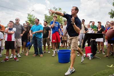 Drew Brees throws a football at the Brees Topgolf Challenge