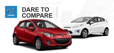 2014 Mazda2 vs. 2014 Ford Fiesta.  (PRNewsFoto/Matt Castrucci Mazda)