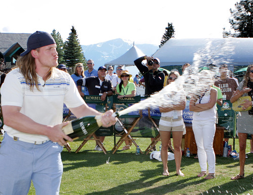 Super Bowl XLV Linebacker A.J. Hawk blasted a 337-yard drive to score the champion title at the Korbel Long Drive Contest, held during the 2011 American Century Celebrity Golf Championship in Lake Tahoe, NV.  Having won the Long Drive Contest in 2009, Hawk accepted his trophy, popped the cork on a large bottle of Korbel and sprayed the enthusiastic crowd  with championship style.  (PRNewsFoto/Korbel Champagne Cellars)