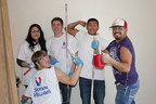 Participants of the YouthBuild program, along with Community Council of Idaho staff members, paint the inside of three single-unit houses at El Milagro.   Participantes del programa YouthBuild, y miembros del Community Council of Idaho, pintan el interior de tres casas en la comunidad El Milagro.
