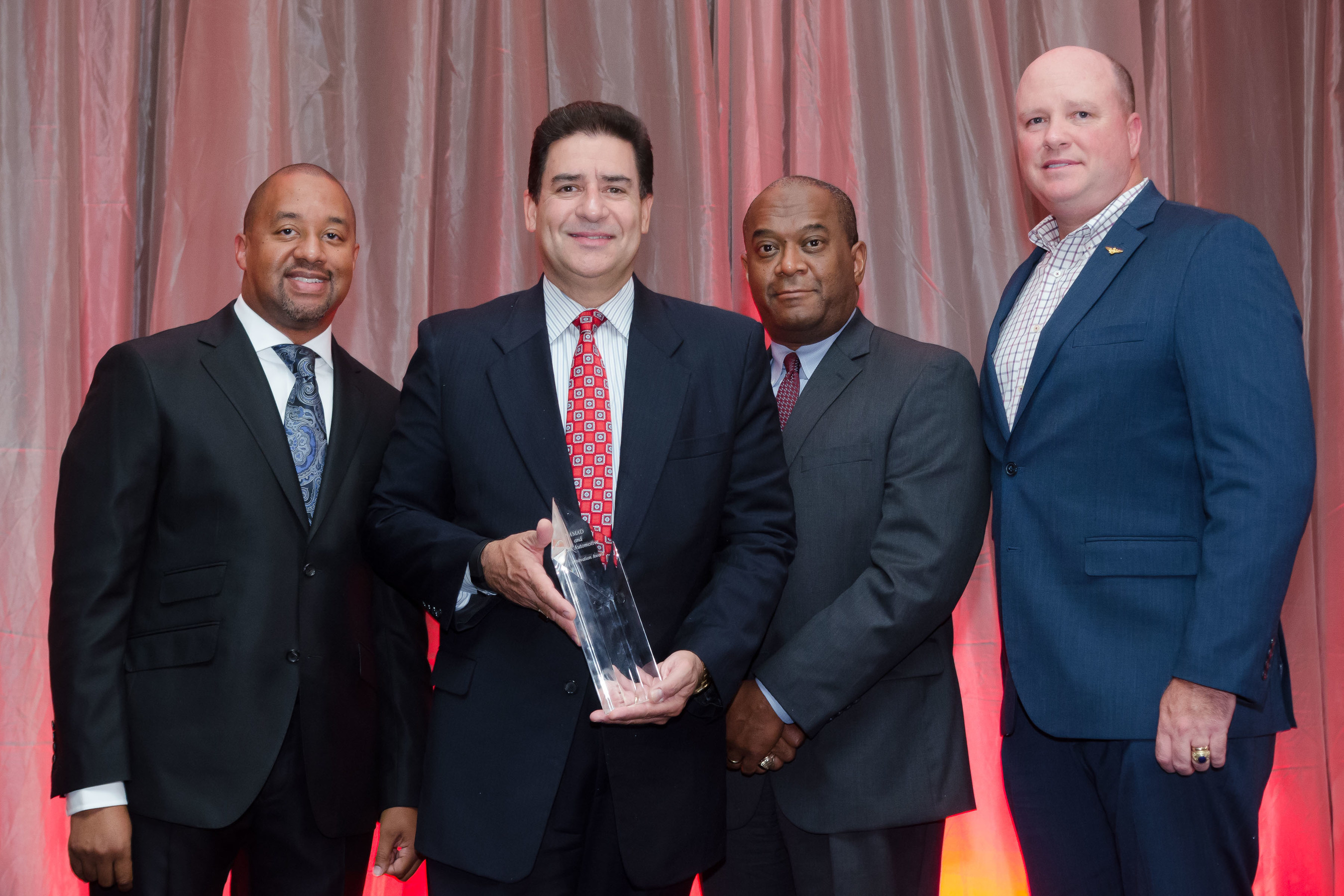 CARLOS LIRIANO OF LOST PINES TOYOTA RECEIVES SECOND ANNUAL INNOVATION AWARD FROM NAMAD AND COX AUTOMOTIVE. Pictured L to R: Damon Lester, President, NAMAD; Carlos Liriano, Dealer Principal, Lost Pines Toyota; Rock Anderson, Chief People Officer, Cox Automotive; Kevin Filan, VP, Customer & Industry Marketing, Cox Automotive
