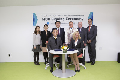 HUYA Bioscience International Expands into South Korea - photo from left to right: Ms. JungSuk Shin, Ms. Hailey Jung, Dr. Sanghoon Shin, Dr. Dennis Gillings, Dr. Bob Goodenow, Mr. Clem Gingras and (sitting in the chairs) Dr. Sang Aun Joo and Dr. Mireille Gillings, HUYA's founder, CEO & Executive Chairman.