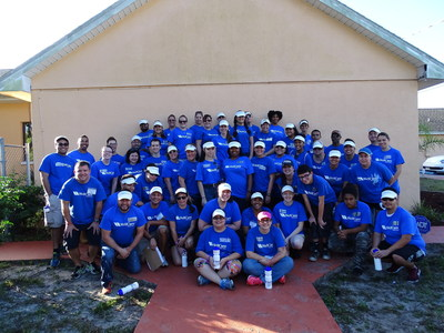 """A team of volunteers from WellCare Health Plans assists with the revitalization of homes in Tampa's Grant Park neighborhood, as part of Habitat for Humanity's """"A Brush with Kindness"""" program."""