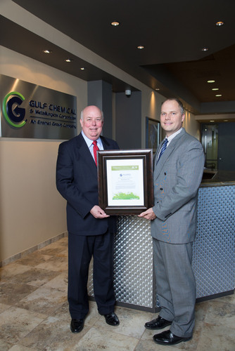 Sam Henry, GDF SUEZ, presents B.J. Stephan, GCMC, with a REC certificate to support GCMC's commitment to ...