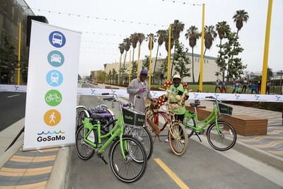 Two participants show off their custom bikes at the Colorado Esplanade opening just before the kickoff of Coast 2016 alongside Santa Monica's Breeze Bike Share. Santa Monica, California. June 5, 2016. Photographer: Kristina Sado