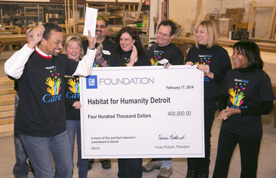 Habitat for Humanity Detroit Executive Director Vincent Tilford (left) celebrates as General Motors Foundation President Vivian Pickard (right) presents a check for $400,000 to the organization in honor of former General Motors Chairman and CEO Dan Akerson and his wife Karin, Monday, February 17, 2014 in Detroit, Michigan. The Capuchin Soup Kitchen and the Coalition on Temporary Shelter (COTS), will also receive donations in honor of the Akersons who made significant personal donations to these organizations during their time in Detroit. (Photo by Jonn F. Martin for the GM Foundation).  (PRNewsFoto/General Motors Foundation)