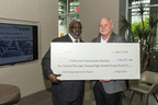 (Left - Right) Mitchell King, region manager for Georgia Power, presents Mike Weems, vice president of DeBartolo Construction Services, with a rebate check for energy efficiency upgrades at The Office.