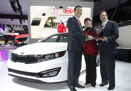 2013 Kia Optima Named 'International Car of the Year' by Road & Travel Magazine - Michael Sprague, executive vice president of marketing & communications, Kia Motors America (left); Courtney Caldwell, editor-in-chief Road and Travel Magazine (center); Mike Martini, president, Consumer OE, Bridgestone Americas (right).  (PRNewsFoto/Kia Motors America)