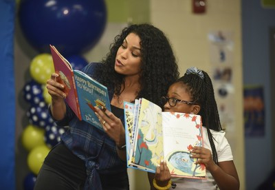 """Singer and actress Jordin Sparks reads from Dr. Seuss' """"Happy Birthday to You!"""" with a student from Amidon-Bowen Elementary School during Reading Is Fundamental's 50th Anniversary on Wednesday, Sept. 14, 2016, in Washington. (Kevin Wolf/AP Images for Reading Is Fundamental)"""
