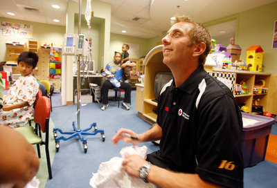 "Driver of the No. 16 American Red Cross Ford Greg Biffle visits with children at the Sunrise Children's Hospital in Las Vegas, NV. Biffle, a blood donor and Red Cross supporter, is in town for the Kobalt Tools 400. ""As a blood donor, I can save a life - meeting children who have benefitted really drives home the point,"" said Biffle. ""The gift of a blood donation cannot be replaced by anything else in the world, and it means a world of difference to those in need.""  (PRNewsFoto/American Red Cross, Isaac Brekken)"