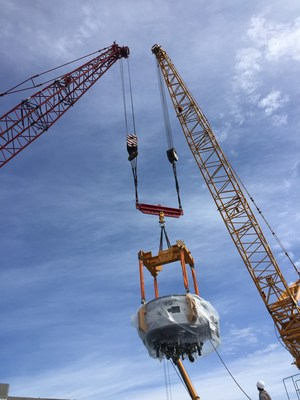The cyclotron being lifted by crane for installation at St. Petersburg.