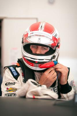 Michael Cooper drives MAZDASPEED3 to 2012 Pirelli World  Challenge Touring Car Championship.  (PRNewsFoto/Mazda North American Operations)