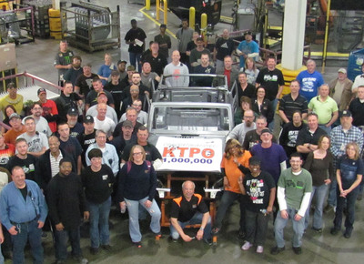 Production workers at KUKA Toledo Production Operations/KTPO gather around the 1,000,000th body-in-white Jeep Wrangler built at the seven-year-old plant in Ohio. The KTPO operation ranks consistently among the most efficient body shops in the North American auto industry - and is part of Chrysler's Toledo Supplier Park.  (PRNewsFoto/KUKA Systems Corporation North America)
