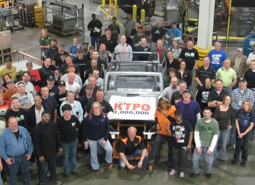 Production workers at KUKA Toledo Production Operations/KTPO gather around the 1,000,000th body-in-white Jeep ...
