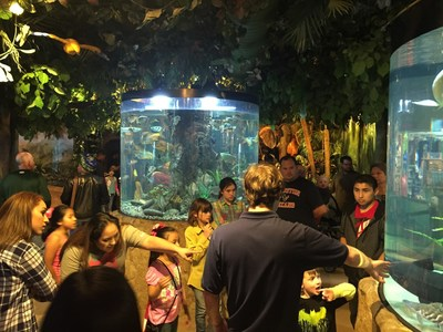 Wounded Warrior Project Alumni and their families explore the fishtanks at the Kemah Aquarium, during an Alumni Program event.