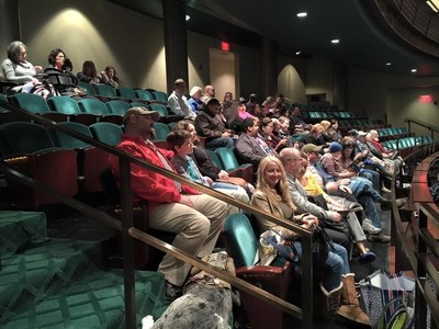 Wounded veterans attend Cesar Millan show.