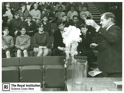 Children listen to a Royal Institution Christmas Lecture from George Porter in 1969. Since 1825 children and their parents have been enchanted by presentations of scientific and mathematical exploration delivered by the premier scientists of the day. As 2014 winners of the EMC Heritage Trust award, the Royal Institution will embark on a digitization project that will make these invaluable lectures available online to a global audience.