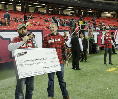 Wounded Warrior Project Alumnus Bobby Woods presented with the check from Brawny.