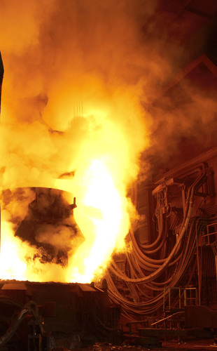Pouring of molten steel in the foundry with near-by hydraulic fluid hoses. (PRNewsFoto/Quaker Chemical ...