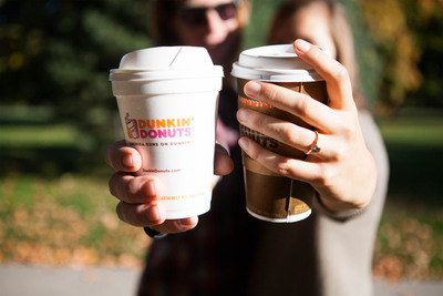 Dunkin' Donuts celebrates Valentine's Day with a full schedule of social programming: chance to win a year's worth of coffee and donuts with #DunkinLoveContest on Instagram, a Facebook Live musical performance with Us The Duo, an iMessage custom card builder, the launch of an emoji keyboard and new Snapchat geofilters. Pictured: Olivia and Rob, a young couple from Missouri whose love story involved Dunkin' Donuts from their first date to their wedding.  (PRNewsFoto/Dunkin' Donuts)