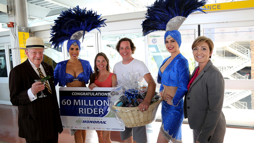 Las Vegas Ambassador Oscar Goodman, 60 millionth rider Steve Riley and wife Laura Riley, Las Vegas Monorail Company Vice President and CMO Ingrid Reisman and showgirls mark the occasion (PRNewsFoto/Las Vegas Monorail Company)