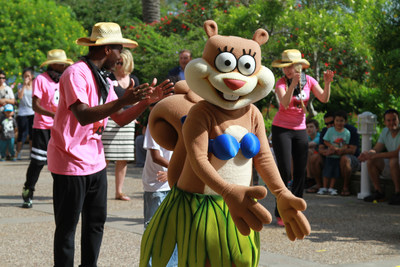 Nickelodeon character Sandy Cheeks shows her dance moves with the Sweft Washington Dance Troupe at Moody Gardens grand opening of SpongeBob SubPants Adventure May 23