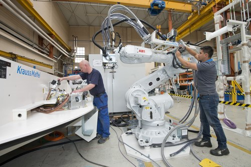 Reaction Process Machinery: Installation of a rotary table to encapsulate cables for a customer in the ...