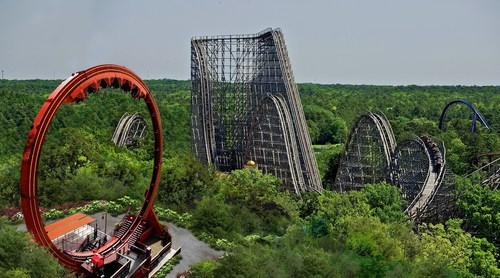 Six Flags Great Adventure debuts Looping Dragon in 2015. This thrill ride rockets riders forward and backward ...