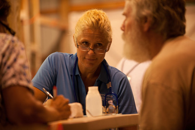 Amerigroup Chief Medical Officer Dr. Mary McCluskey volunteers in the triage unit at the RAM clinic in Wise, Va.