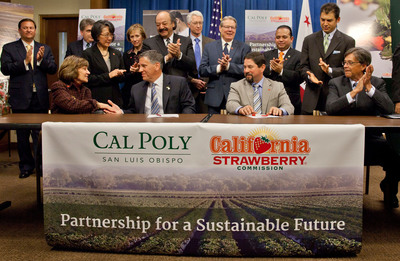 Jeffrey D. Armstrong, president, Cal Poly San Luis Obispo, second from left, front row and Victor Ramirez, chairman of the board, California Strawberry Commission, second from right, front row, sign a partnership agreement between the California Strawberry Commission and the university at the state Capitol in Sacramento, Calif., Tuesday, February 19, 2013. The $1 million gift will create the Strawberry Sustainability Research and Education Center at Cal Poly, San Luis Obispo. Far left, front row is Karen Ross, Secretary of the California Department of Food and Agriculture, far right is Matt Rodriquez, California Secretary for Environmental Protection. Back row, left to right, Bill Reiman, board member, California Strawberry Commission, Chris Reardon, Chief Deputy Director, Department of Pesticide Regulation, Genevieve Shiroma, Chairwoman, Agricultural Labor Relations Board, Carol Chandler, former CSU Trustee, Assemblymember Katcho Achadjian, Brian Leahy, Director, California Department of Pesticide Regulation, State Senator Bill Monning, Assemblymember Luis Alejo and Assemblymember Das Williams.