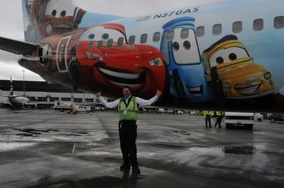 Alaska Dean Potter Seattle supervisor with Alaska's fifth Disney-themed plane.  (PRNewsFoto/Alaska Airlines)