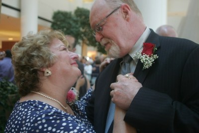 A couple smiles at each other after renewing their vows at Love at the Renaissance. (PRNewsFoto/Renaissance Schaumburg)