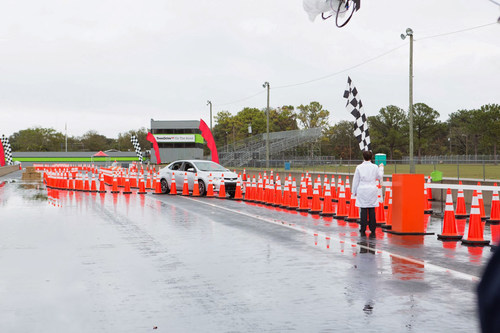 A teen participant navigates the course during Toyota's TeenDrive365 teen driver experience, a free ...