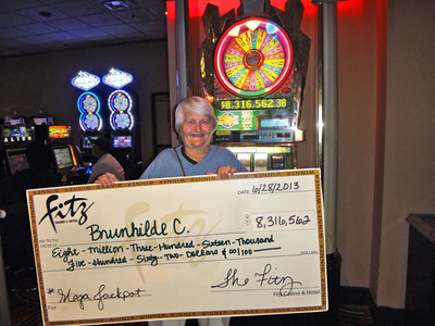 Brunhilde C. celebrates becoming one of the newest millionaires in the country after winning an $8.3 million dollar jackpot as she played a 25-cent statewide progressive Wheel of Fortune(R) machine at the Fitz Casino in Tunica, Mississippi.  (PRNewsFoto/Fitz Casino & Hotel, Tunica)