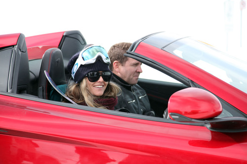 "Pikes Peak record holder Rhys Millen drives the McLaren 12C Spider ""racing"" snowboarder Chanelle Sladics on Loveland Pass in Colorado.  (PRNewsFoto/McLaren Automotive)"