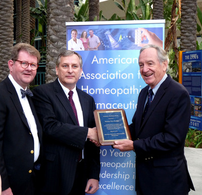 American Association of Homeopathic Pharmacists member J.P. Borneman, PhD and president Mark Land honor Senator Tom Harkin (D-Iowa) with a Legislative Excellence Award for safeguarding Americans' right to choose complementary health care.  (PRNewsFoto/American Association of Homeopathic Pharmacists)