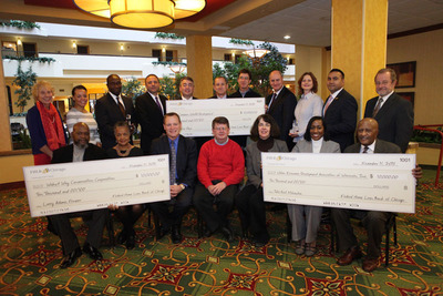 Walnut Way Conservation Corporation, Common Wealth Development, and Urban Economic Development Association of Wisconsin, Inc. each receive $10,000 Community First(TM) Award from the Federal Home Loan Bank of Chicago. Pictured with the award recipients are Federal Home Loan Bank of Chicago President & CEO Matt Feldman, and Federal Home Loan Bank of Chicago Community Investment Officer Sam Nicita.  (PRNewsFoto/Federal Home Loan Bank of Chicago)