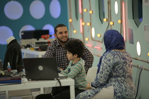 Abderrahim shares the first iteration of his smart autism shirt with potential end users (PRNewsFoto/Stars of Science)