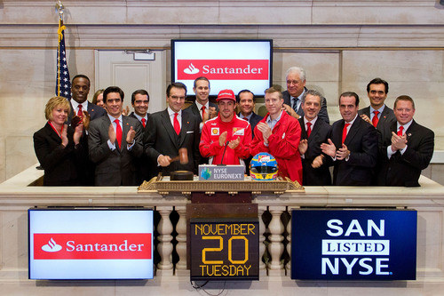Jorge Moran, President & CEO of Sovereign Bank, N.A. and Santander U.S. Country Head along with Fernando Alonso, Scuderia Ferrari Team Driver, rings the closing bell at the New York Stock Exchange on November 20, 2012 in New York City. (Photo by Ben Hider/NYSE Euronext).  (PRNewsFoto/Sovereign Bank)