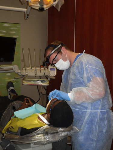 A prosthodontist performs an oral cancer screening in Phoenix, Arizona. Prosthodontists play an important role ...