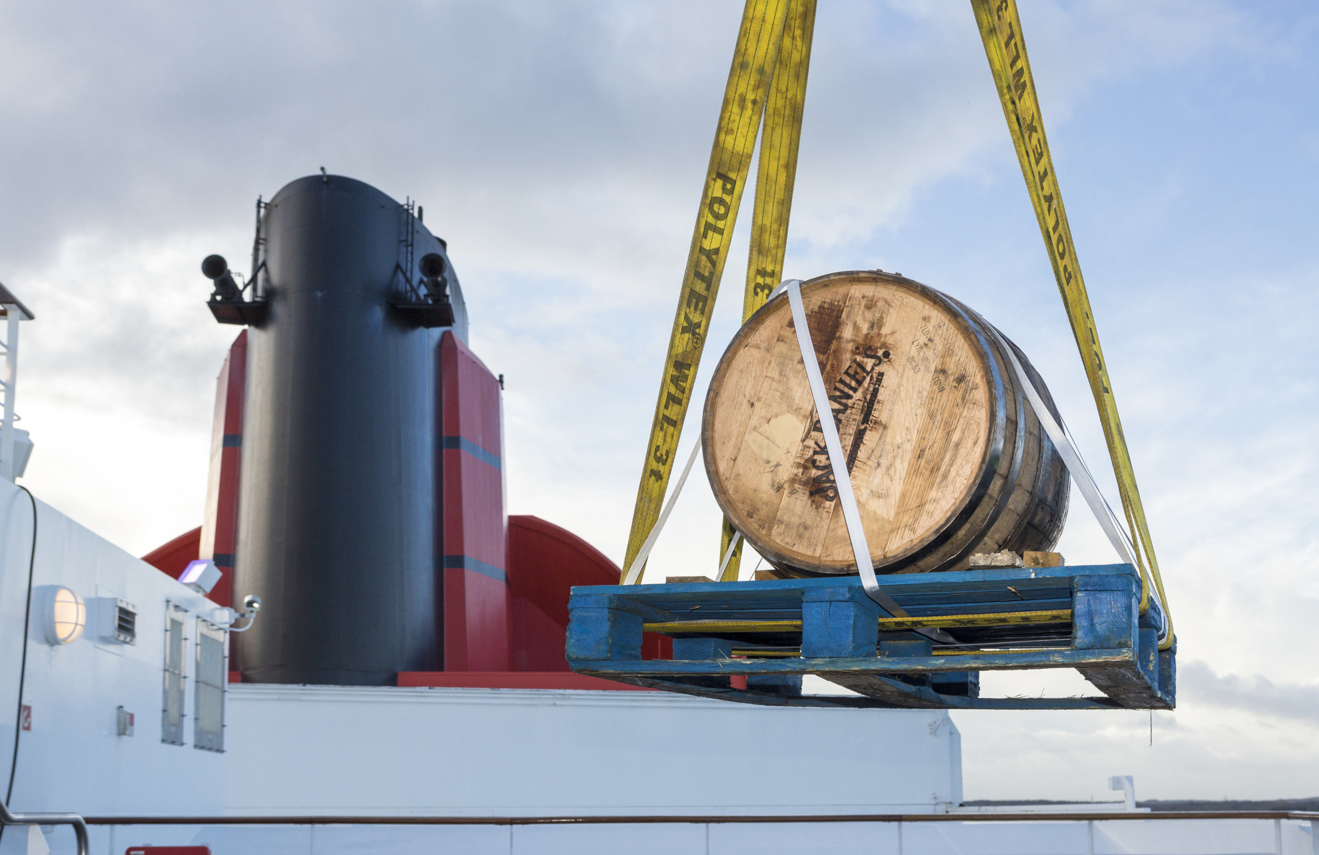 A 300 litre Jack Daniel's barrel being hoisted by crane onto Queen Mary 2 in Southampton, England on Sunday, Jan. 10, 2016.