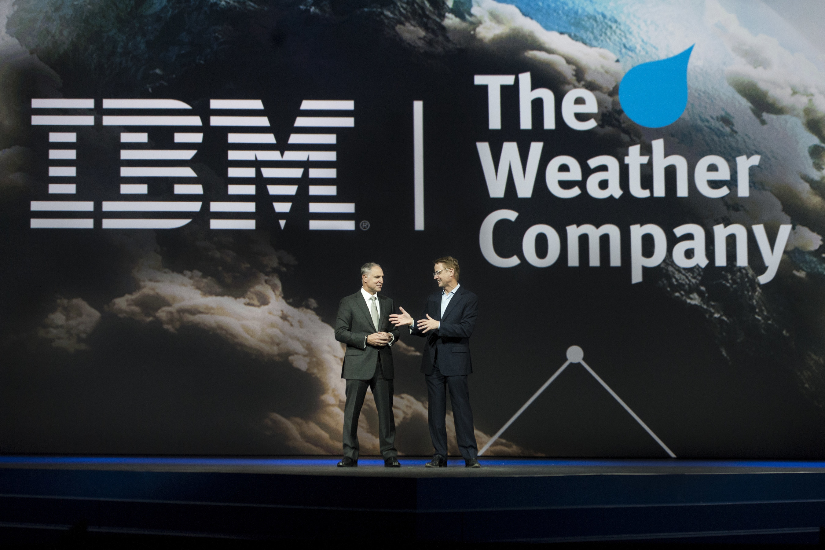 IBM Senior Vice President Bob Picciano (left) joins The Weather Company Chairman & CEO David Kenny (right) at the IBM Insight Conference in Las Vegas. IBM has entered into a definitive agreement to acquire The Weather Company's B2B, mobile and cloud-based web properties, including WSI, weather.com, Weather Underground and The Weather Company brand.